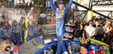 NASCARSun10-MClery Kyle Busch celebrates in victory lane after winning the Apache Warrior 400 at Dover International Speedway on Sunday. Delaware State News/Marc Clery